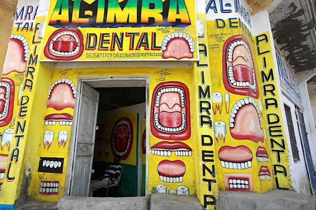 <p>Somali dentist Hassan Ali, 35, sits inside his dental clinic with murals painted on the walls in Hamarweyne district of Mogadishu, Somalia, June 7, 2017. (Photo: Feisal Omar/Reuters) </p>