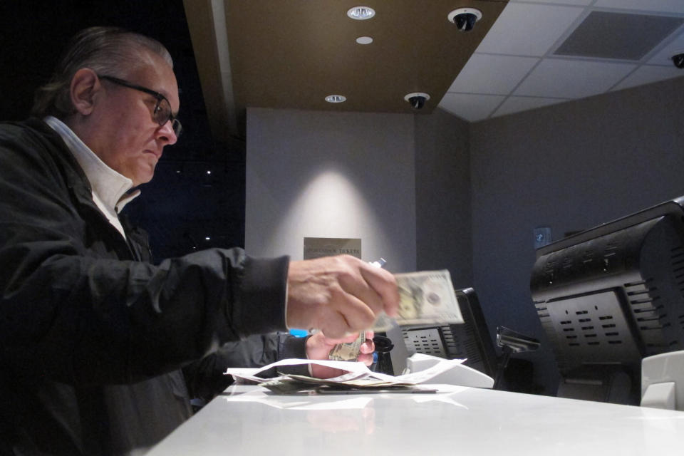 A gambler makes a sports bet at Bally's casino in Atlantic City N.J. on Jan. 29, 2020. On Wednesday, Jan. 6, 2021, New York's governor did an about-face and embraced mobile sports betting as a way to deal with financial losses from the coronavirus pandemic, and a company that tracks gambling legislation and performance predicted revenue from legal sports betting could reach $3.1 billion in 2021 and as much as $10 billion within five years. (AP Photo/Wayne Parry)