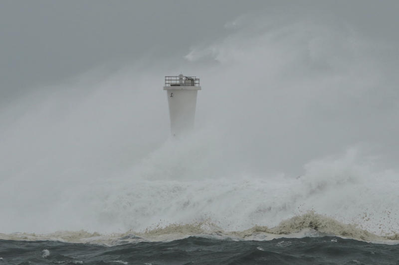 Surging waves hit against the breakwater and a lighthouse as Typhoon Hagibis approaches at a port in town of Kiho, Mie prefecture, central Japan, Oct. 12, 2019. Tokyo and surrounding areas braced for a powerful typhoon forecast as the worst in six decades, with streets and trains stations unusually quiet Saturday as rain poured over the city. (Photo: Toru Hanai/AP)