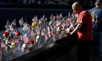 Flags and flowers adorn the names of the victims of the attacks of Sept. 11, 2001, at the National September 11 Memorial in New York on the 20th anniversary of the attacks, Saturday, Sept. 11, 2021. (Craig Ruttle/Newsday via AP, Pool)