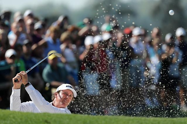 Phil Mickelson of the U.S. hits from a sand trap on the 18th green during the second day of practice for the 2018 Masters golf tournament at Augusta National Golf Club in Augusta, Georgia, U.S. April 3, 2018. REUTERS/Lucy Nicholson