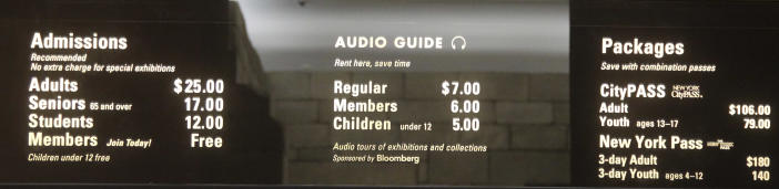 """In this Tuesday, March 19, 2013 photo, the board at the Metropolitan Museum of Art in New York displays admission fees, which are recommended but not mandatory. Many visitors to the museum, especially foreign tourists, don't realize that the fees listed on the sign are merely suggestions. Confusion over what's required to enter the Met, which draws more than 6 million visitors a year, is at the heart of a class-action lawsuit this month accusing it of an illegal """"scheme"""" to defraud the public into believing the fees are required. (AP Photo/Mary Altaffer)"""