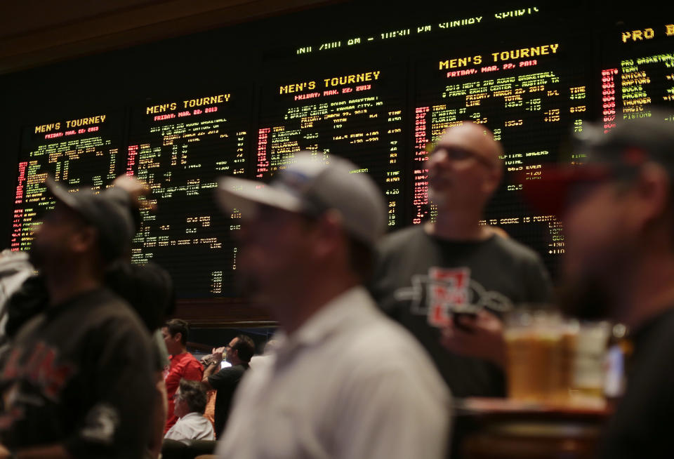 Fans watch the 2013 NCAA tournament at the Mirage in Las Vegas. (AP Photo/Julie Jacobson)