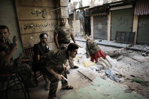 Free Syria Army fighters man a position in the Old City of Aleppo