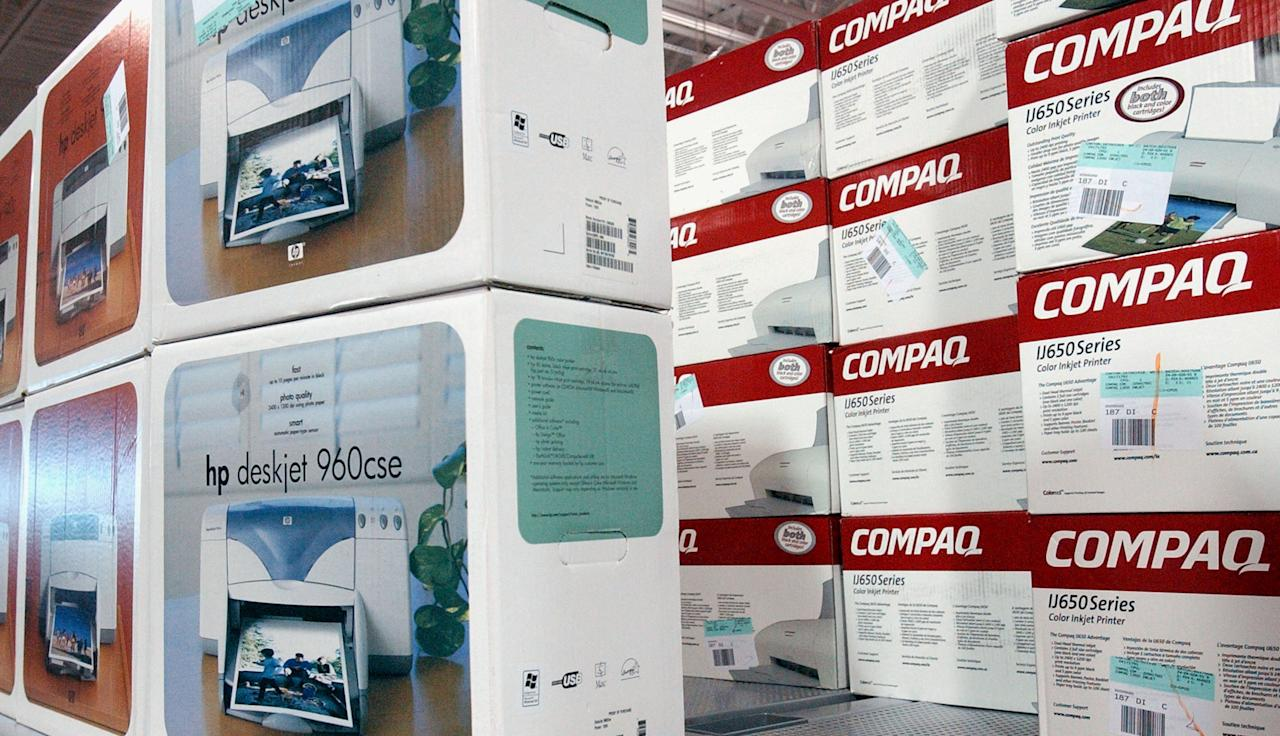 402026 01: Compaq and Hewlett Packard printer boxes share shelf space at a Best Buy store March 7, 2002 in San Francisco, CA. Standard & Poors cut Hewlett-Packard Co.s long-term debt ratings three notches because because of falling profits and risks associated with its proposed merger with lower-rated rival Compaq Computer Corp. (Photo by Justin Sullivan/Getty Images)