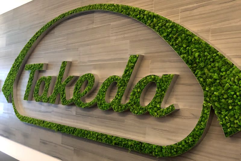 A Takeda logo is seen in its research hub in Cambridge