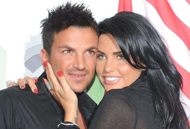 FILE - British model Katie Price and her musician husband Peter Andre, pose together in this April 14, 2009 file photo. According to news reports in London, Monday May 11, 2009, the couple are to separate after four and a half years of marriage.(AP Photo Ian West, pa, file) **UNITED KINGDOM OUT: NO SALES: NO ARCHIVE:**