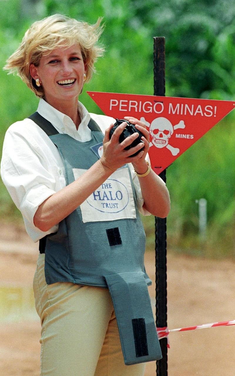 Diana, Princess of Wales, holds a land mine during her visit to a mine field in Luena  - Credit: JOSE MANUEL RIBEIRO/Reuters