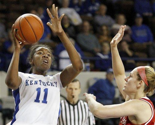 Kentucky's DeNesha Stallworth (11) shoots as Miami (Ohio) forward Jessica Rupright defends during the first half of an NCAA college basketball game at Memorial Coliseum in Lexington, Ky., Wednesday, Nov. 28, 2012. (AP Photo/James Crisp)