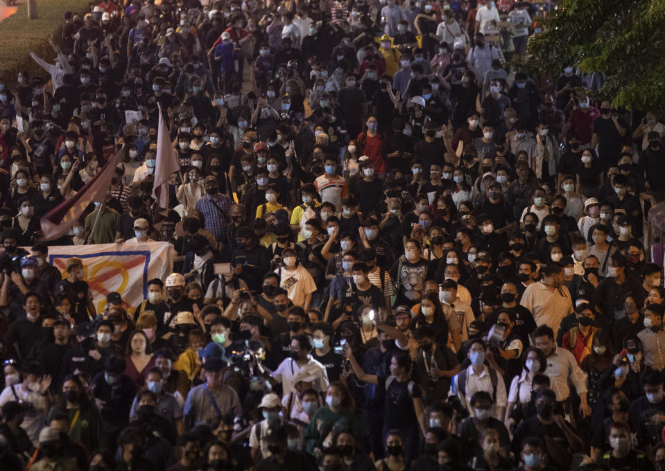Hundreds of pro-democracy protesters demanding the release of pro-democracy activists march in Bangkok, Thailand, Wednesday, Feb. 10, 2021. Protesters demanded the government to step down, the constitution to be amended to make it more democratic and the monarchy be more accountable. (AP Photo/Sakchai Lalit)