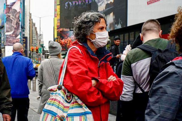 PHOTO: People wear face masks in Times Square on March 03, 2020 in New York City. (View Press/Corbis via Getty Images)