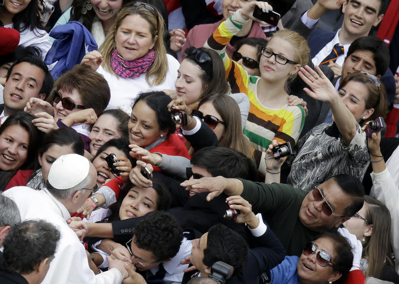Pope Francis, bottom left, greets the faithful at the end of his general audience, in St. Peter's Square, at the Vatican, Wednesday, March 27, 2013. Francis has called for an end to the violence and looting that has accompanied the weekend coup in the Central African Republic in his first such appeal for peace since becoming pope. (AP Photo/Gregorio Borgia)