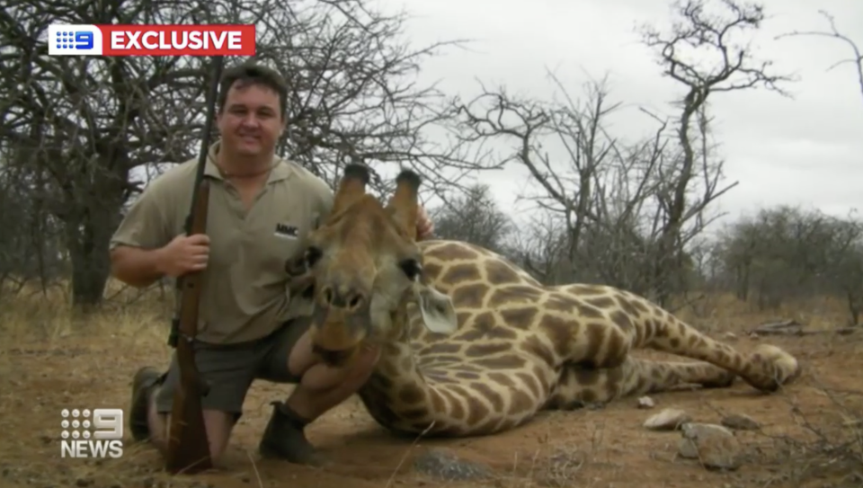 Jewell Crossberg, pictured with a dead giraffe, has been appointed acting district manager of the Western Australian Department of Biodiversity, Conservation and Attractions in Esperance. Source: Nine News