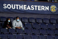 Fans wear masks and sit in marked-off seats at an NCAA college basketball game in the Southeastern Conference tournament Wednesday, March 10, 2021, in Nashville, Tenn. Large buildings with high ceilings and ventilation systems that can change out fresh air almost a third as well as airplanes are reasons why experts and engineers believe it's reasonable for limited numbers of fans to be returning to live, indoor sporting events. They say masks are still necessary, but most professional and big college arenas like the ones that host NHL and NBA games and the NCAA Tournament have the capacity to make it work and keep people from spreading the coronavirus. (AP Photo/Mark Humphrey)