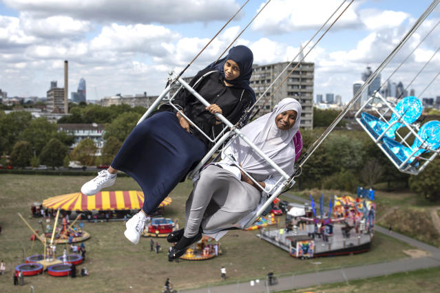 <p>Children enjoy a ride during an Eid in the Park celebration marking the start of Eid Al-Adha at Burgess Park on August 21, 2018 in London, England. The traditional four-day celebratory festival marks one of the holiest days in the Islamic religious calendar. (Photo by Dan Kitwood/Getty Images) </p>