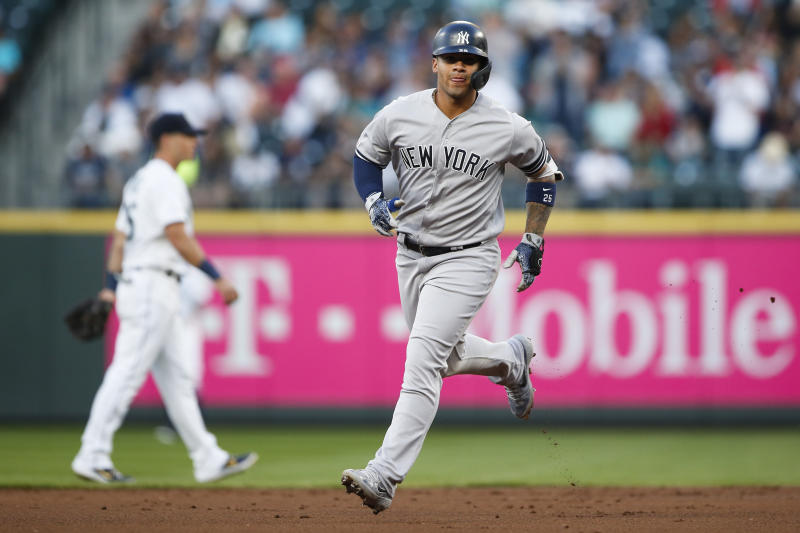 Aug 26, 2019; Seattle, WA, USA; New York Yankees shortstop Gleyber Torres (25) runs the bases after hitting a solo home run against the Seattle Mariners during the second inning at T-Mobile Park. Mandatory Credit: Joe Nicholson-USA TODAY Sports