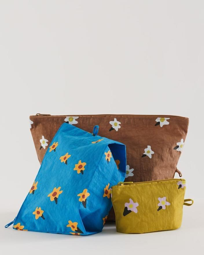 """You can never have too many organizational pouches. Use them for toiletries, for cords, or any little bits and bobs. $38, Baggu. <a href=""""https://baggu.com/collections/travel/products/go-pouch-set-painted-daisies"""" rel=""""nofollow noopener"""" target=""""_blank"""" data-ylk=""""slk:Get it now!"""" class=""""link rapid-noclick-resp"""">Get it now!</a>"""