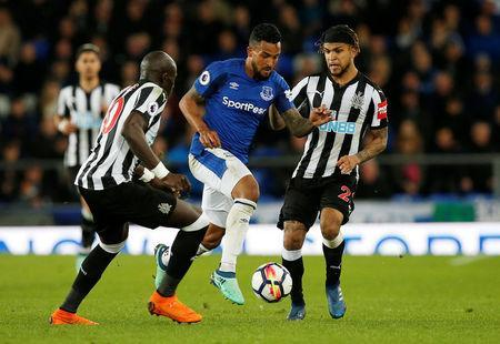Soccer Football - Premier League - Everton v Newcastle United - Goodison Park, Liverpool, Britain - April 23, 2018 Everton's Theo Walcott in action with Newcastle United's DeAndre Yedlin and Mohamed Diame