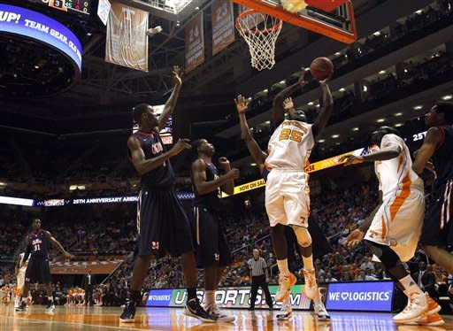 Tennessee forward Dwight Miller (25) shoots the ball during the first half of an NCAA college basketball game against Mississippi at Thompson-Boling Arena in Knoxville, Tenn., Wednesday, Feb. 22, 2012. (AP Photo/Knoxville News Sentinel, Adam Brimer)