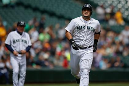 Jesus Montero rounds the bases after hitting a home run during a 2014 game. (Getty)