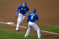 Toronto Blue Jays' Danny Jansen, left, is congratulated by third base coach Luis Rivera (4) after hitting a solo home run against the New York Yankees during the fourth inning of a baseball game in Buffalo, N.Y., Wednesday, Sept. 23, 2020. (AP Photo/Adrian Kraus)