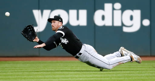 Chicago White Sox's Charlie Tilson makes a diving catch to get out Cleveland Indians' Jake Bauers during the ninth inning of a baseball game, Tuesday, May 7, 2019, in Cleveland. The White Sox defeated the Indians 2-0. (AP Photo/Ron Schwane)