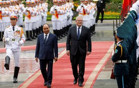 Australia's Prime Minister Scott Morrison reviews the guard of honour with his Vietnamese counterpart Nguyen Xuan Phuc during a welcoming ceremony in Hanoi