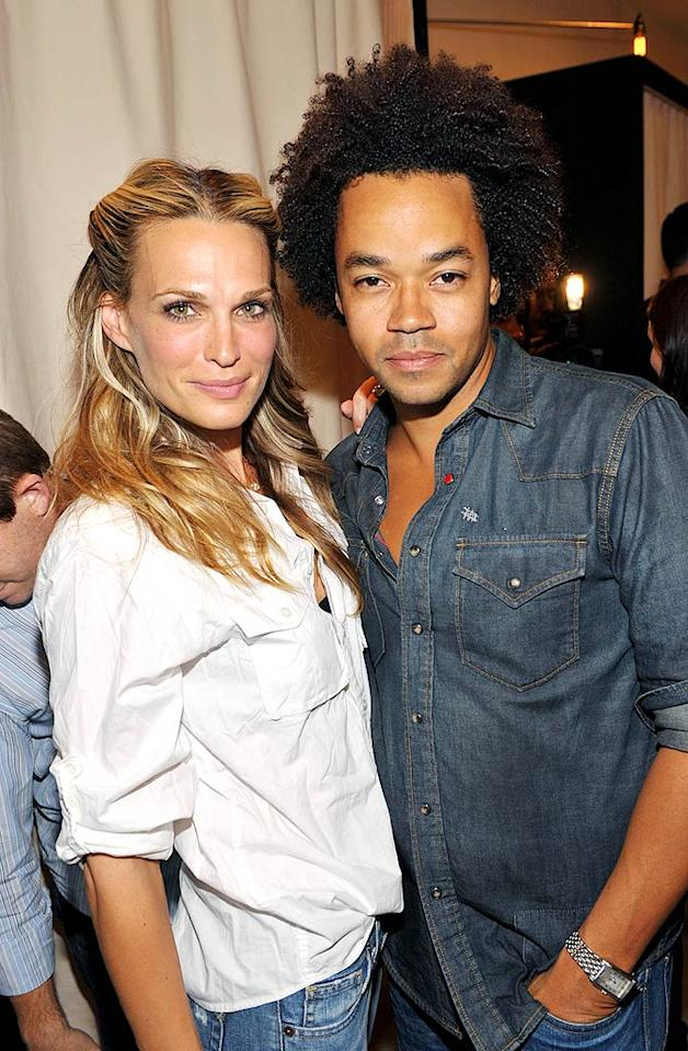 """Molly Sims poses with Gaps EVP of Design, Patrick Robinson, who says the 1969 line (named in honor of the company's debut year) consists of """"great fitting jeans that really complement and accentuate different body types."""" John Shearer/<a href=""""http://www.gettyimages.com/"""" target=""""new"""">GettyImages.com</a> - August 6, 2009"""