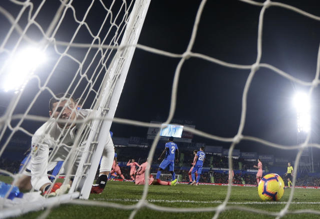 Getafe's David Soria, left, reacts after FC Barcelona's Luis Suarez scored during a Spanish La Liga soccer match between Getafe and FC Barcelona at the Alfonso Perez stadium in Getafe, Spain, Sunday, Jan. 6, 2019. (AP Photo/Manu Fernandez)