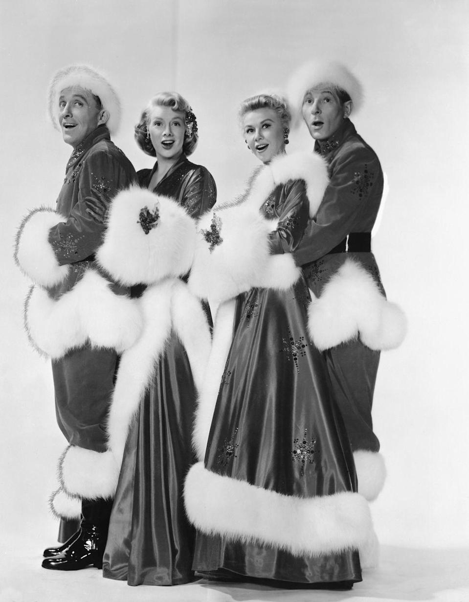 <p>(Left to Right) Bing Crosby, Danny Kaye, Rosemary Clooney, and Vera-Ellen pose for a publicity still to promote the film <em>White</em><em> Christmas</em> in 1954.</p>
