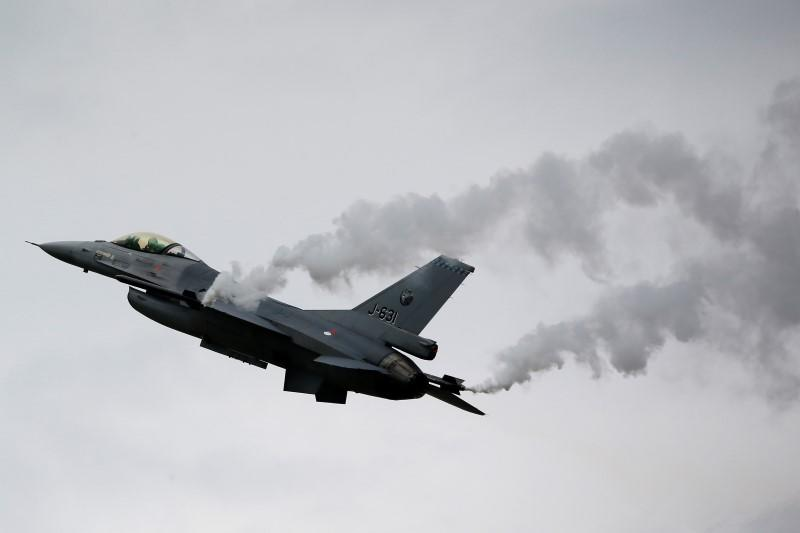 A General Dynamics F-16M Fighting Falcon of the Royal Netherlands Air Force performs during The Royal International Air Tattoo at the RAF in Fairford