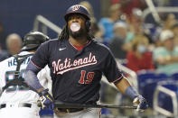 Washington Nationals' Josh Bell (19) blows a bubble after striking out in the second inning of a baseball game against the Miami Marlins, Monday, Sept. 20, 2021, in Miami. (AP Photo/Marta Lavandier)