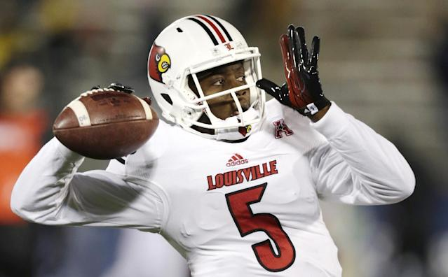 FILE -In this Nov. 8, 2013, file photo, Louisville quarterback Teddy Bridgewater warms up for an NCAA college football game against Connecticut, in East Hartford, Conn. Bridgewater was selected in the first round, 32nd overall, by the Minnesota Vikings in the NFL draft on Thursday, May 8, 2014. (AP Photo/Charles Krupa, File)