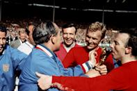 England manager Alf Ramsey (third l) is congratulated by trainer Harold Shepherdson (l), squad members Ron Springett (second l) and Jimmy Armfield (c), and Nobby Stiles (r) as captain Bobby Moore (second r) presents him with the Jules Rimet trophy after England's 4-2 win (Photo by Ron Bell - PA Images/PA Images via Getty Images)