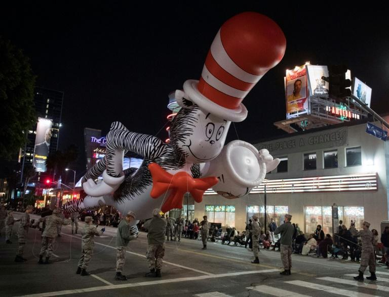 A Dr. Seuss balloon character floats down Sunset Blvd during the 88th annual Hollywood Christmas Parade in Hollywood, California on December 1, 2019