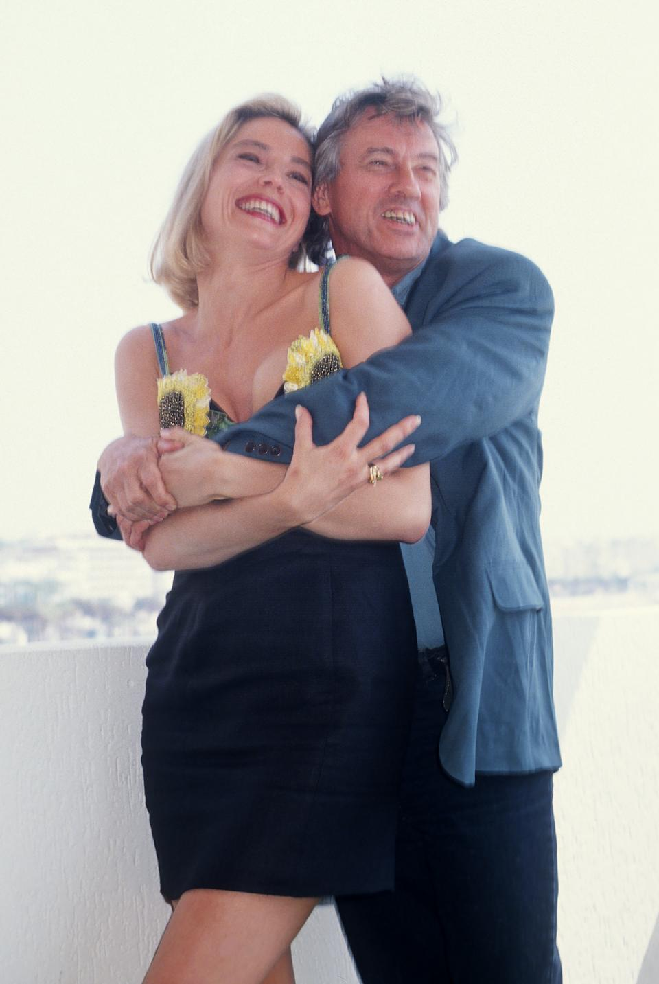 CANNES, FRANCE MAY 1992: Sharon Stone and Paul Verhoeven attend the 45th Cannes film Festival in May 1992, in Cannes, France. (Photo by FocKan/WireImage)