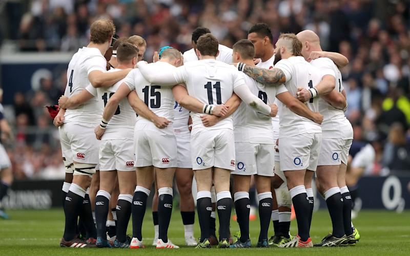 England players in a pre-match huddle during the RBS Six Nations  - Credit: PA Wire