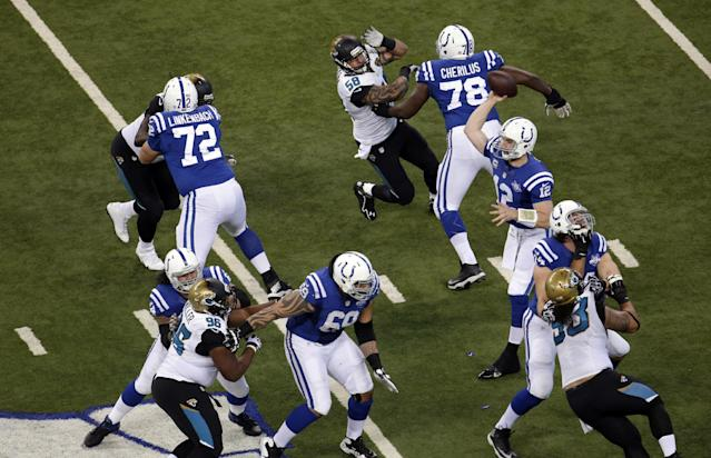Indianapolis Colts' Andrew Luck (12) throws during the first half of an NFL football game against the Jacksonville Jaguars Sunday, Dec. 29, 2013, in Indianapolis. (AP Photo/AJ Mast)