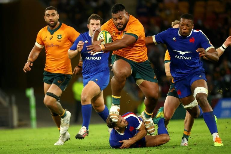 Australia's Taniela Tupou charges through France's Melvyn Jaminet during the first Test in Brisbane on Wednesday