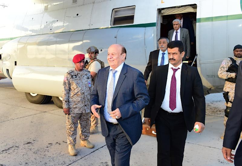 A picture released by the Yemeni Presidency shows Yemen's president Abedrabbo Mansour Hadi (C) smiling after walking off a Saudi air force plane upon his return from exile to the southern city Aden on November 17, 2015 (AFP Photo/)