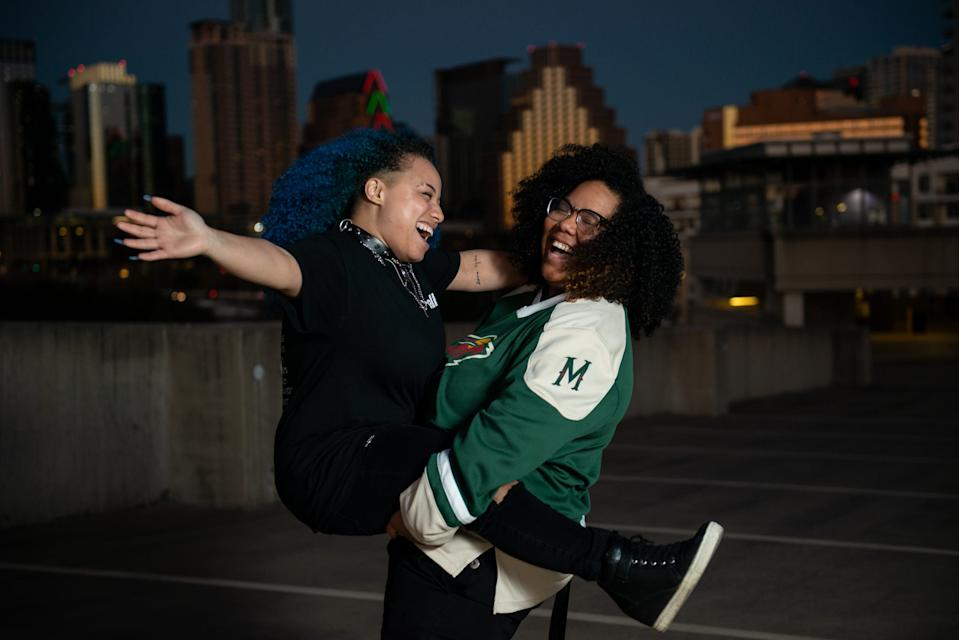 """Rapper Kori Roy, 33, stage name Mama Duke, holds wife and DJ, Keeley Roy, 28, stage name Meme Keeley, in Downtown Austin, Jan. 3, 2021. Meme Keeley started disc jockeying for her wife about 2 years ago. """"I'm there for the whole processes."""" Meme Keeley said it """"made sense"""" to buy a deck and learn how to DJ. [Angela Piazza for Statesman]"""