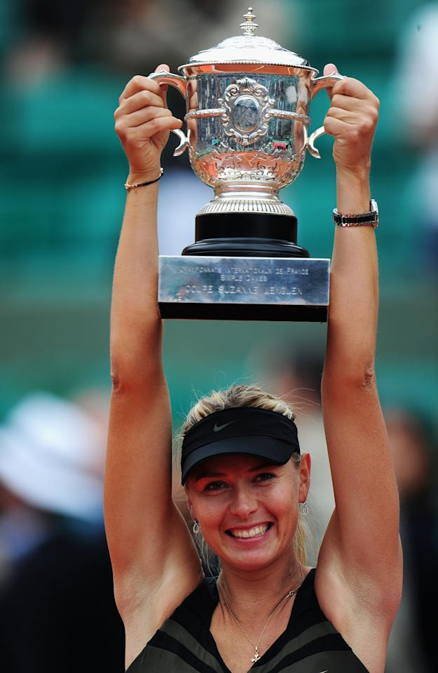 PARIS, FRANCE - JUNE 09:  Maria Sharapova of Russia celebrates with the Coupe Suzanne Lenglen after the women's singles final against Sara Errani of Italy during day 14 of the French Open at Roland Garros on June 9, 2012 in Paris, France.  (Photo by Mike Hewitt/Getty Images)