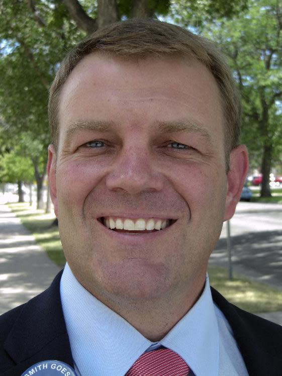 This Monday, Aug. 8, 2016 photo shows Cheyenne attorney Darin Smith, who is one of eight Republican candidates for Wyoming's U.S. House seat. His competitors include Liz Cheney, daughter of former Vice President Dick Cheney. (AP Photo/Mead Gruver)