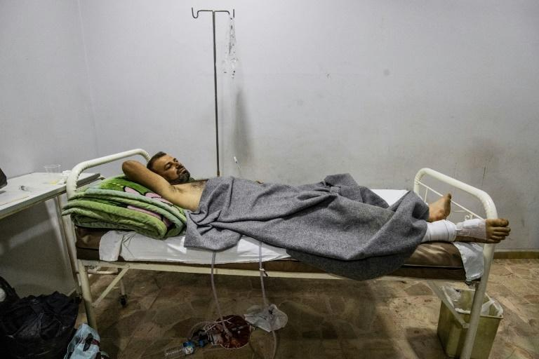 A Syrian patient injured during a Turkish bombardment of Qamishli, receives treatment at Farman hospital in the northeastern Syrian Kurdish city on October 11