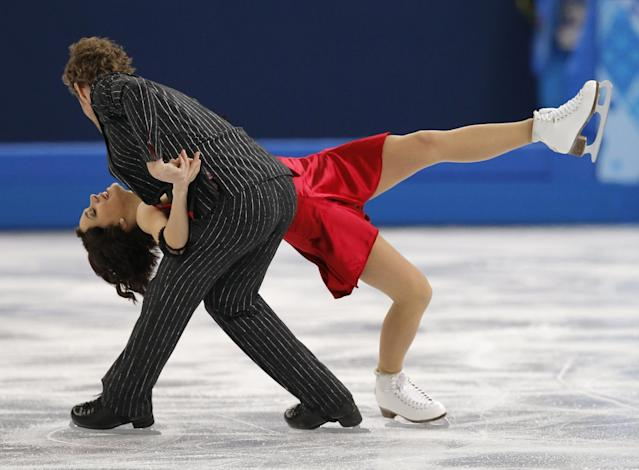 Nathalie Pechalat and Fabian Bourzat of France compete in the ice dance short dance figure skating competition at the Iceberg Skating Palace during the 2014 Winter Olympics, Sunday, Feb. 16, 2014, in Sochi, Russia. (AP Photo/Vadim Ghirda)