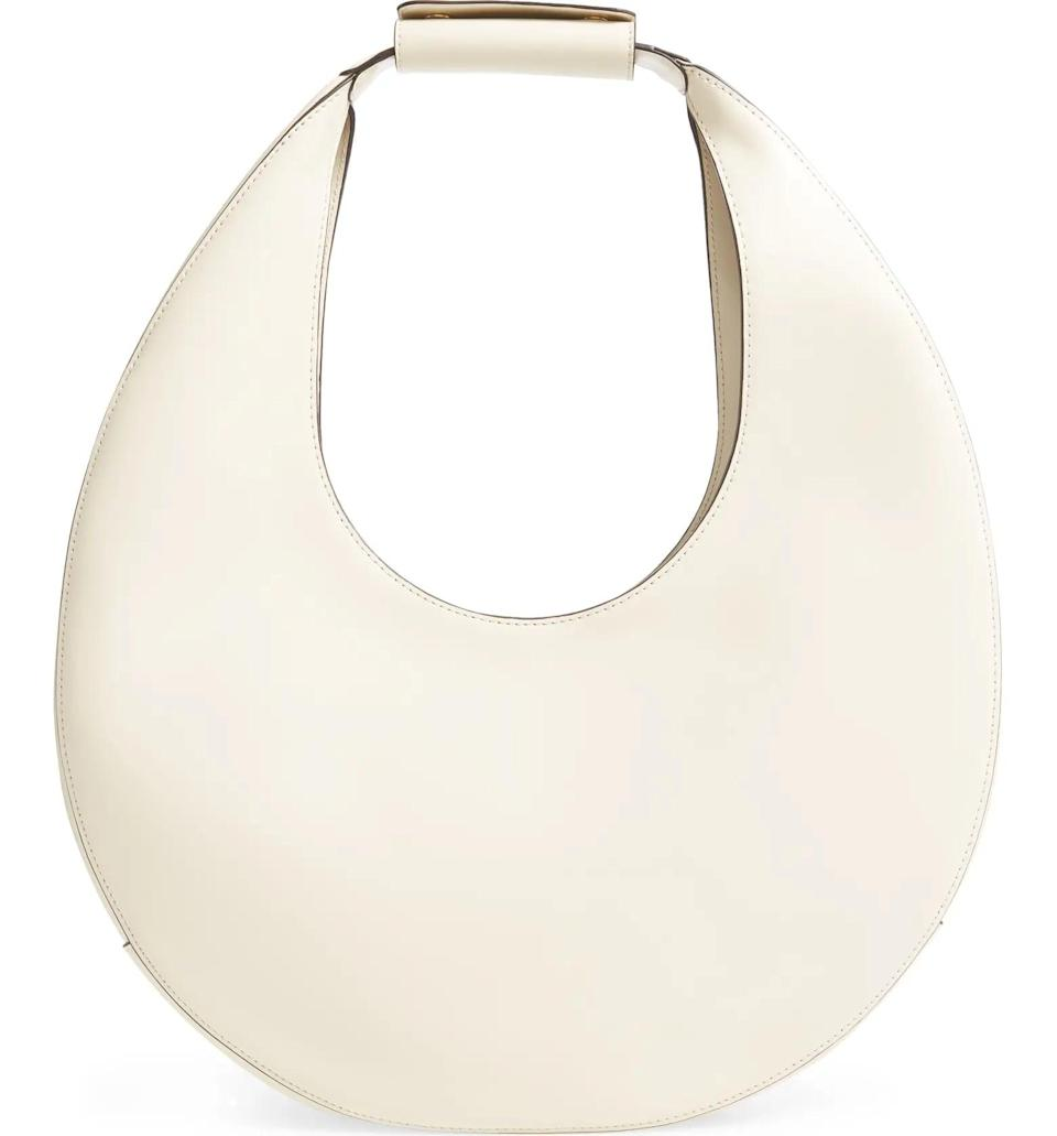 <p>This <span>Staud Large Moon Leather Bag</span> ($395) is a great statement bag that also goes with everything.</p>