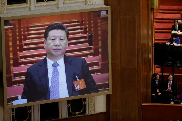 A screen shows Chinese President Xi Jinping during the second plenary session of the National People's Congress.