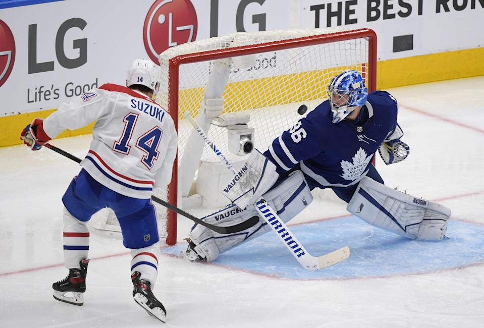 Montreal Canadiens forward Nick Suzuki scores the game-winning goal in overtime of Game 5 against the Toronto Maple Leafs.