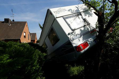 A caravan sits in a garden after a tornado last night hit the area of Boisheim, west of Duesseldorf, Germany, May 17, 2018. REUTERS/Thilo Schmuelgen