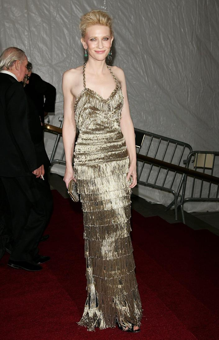 cate blanchett wearing a gold fringe gown at the 2007 met gala